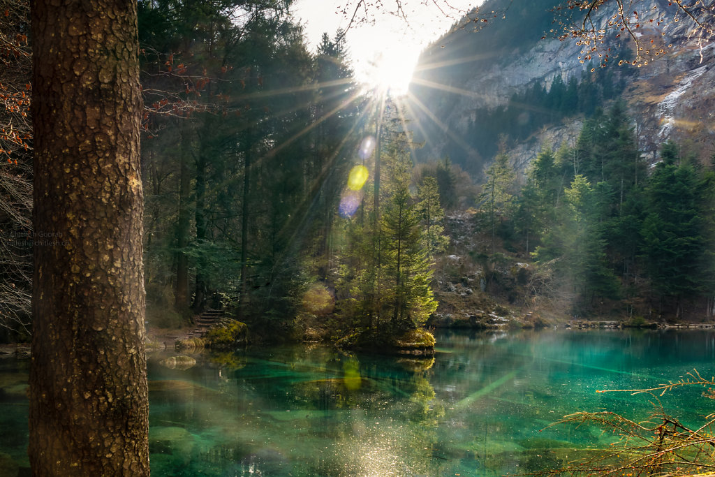 Sun flare at this amazing blue lake